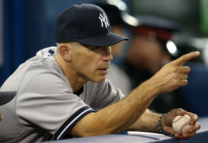 yankees manager joe girardi helps woman after world series inspiring sports moments